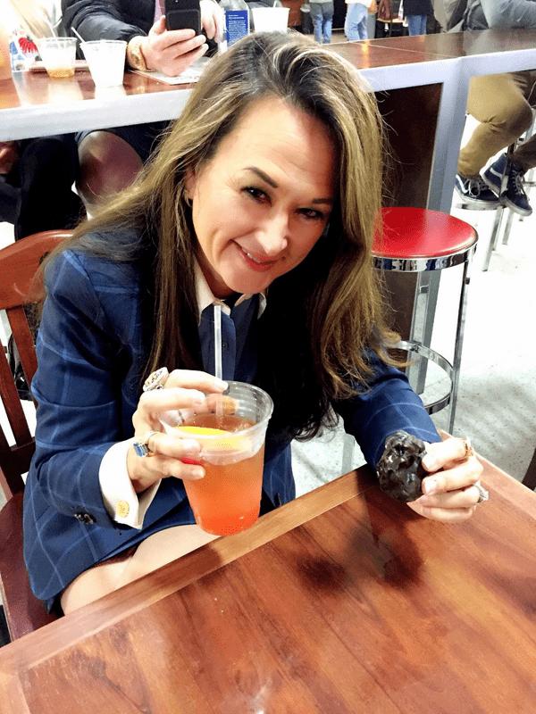 Mimi enjoys a dark chocolate praline & a Hurricane after speaking in New Orleans.